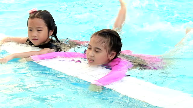 happy swimming girls - elementary age videos stock videos & royalty-free footage