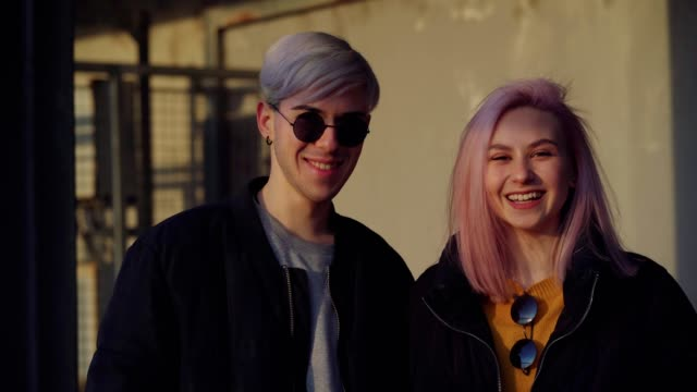 happy teen couple smiling - pink hair stock videos & royalty-free footage