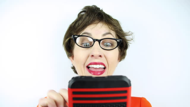 happy texting geek - cat's eye glasses stock videos and b-roll footage