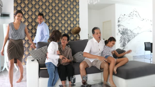 happy thai family greeting grandparents in their home - respect stock videos and b-roll footage