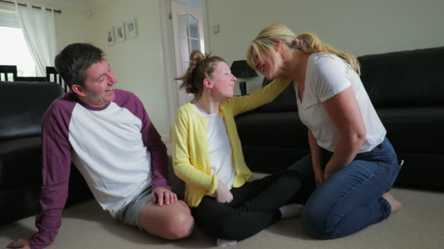 happy time at home with disabled daughter - disability stock videos & royalty-free footage