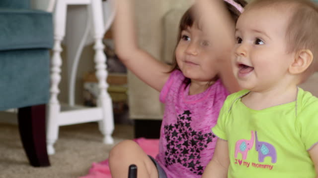 Happy Toddler and Baby Sister Clapping