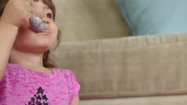Happy Toddler Eating Yogurt