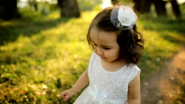 happy toddler girl walking in nature - baby girls stock videos & royalty-free footage