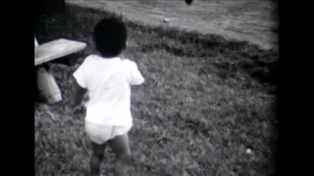 1955 happy toddler in grass - running shorts stock videos & royalty-free footage