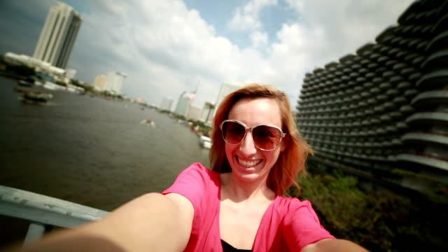 Happy tourist in Bangkok taking selfie