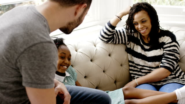 Happy transgender family relaxing at home