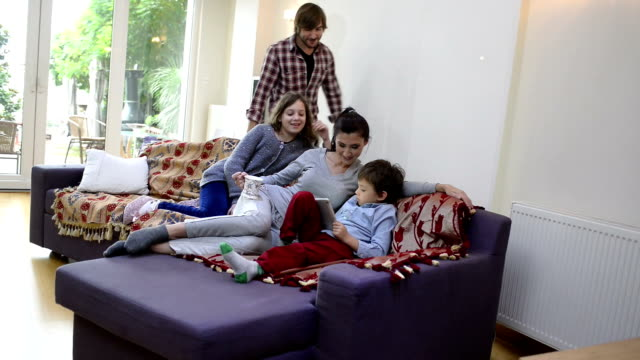 happy turkish family playing with digital tablet together at home - picking up stock videos & royalty-free footage