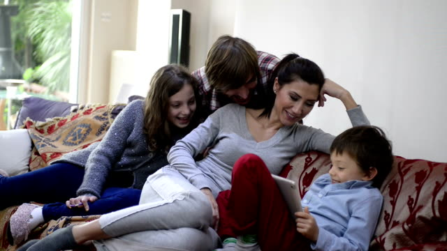 Happy Turkish Family Playing with Digital Tablet Together at Home