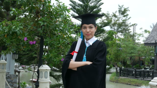 happy university graduate with a diploma , pride gesturing - diploma stock videos and b-roll footage