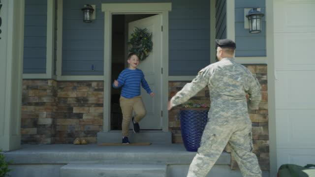 vídeos y material grabado en eventos de stock de happy wife and son greeting soldier returning home from duty / lehi, utah, united states - lehi