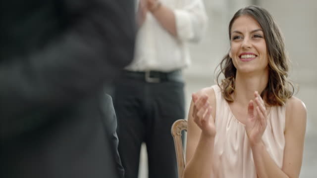 SLO MO Happy woman at wedding clapping her hands