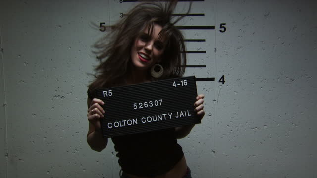 a happy woman being booked for a crime - altri spezzoni di questa ripresa 1146 video stock e b–roll