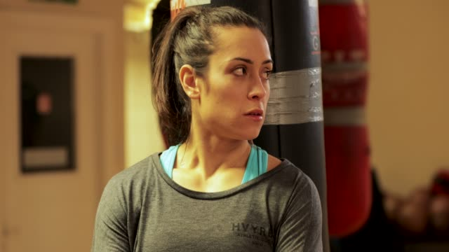 happy woman boxing instructor - combat sport stock videos and b-roll footage