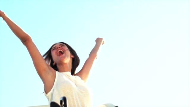 happy woman cheering while enjoying road trip - woman doorway stock videos & royalty-free footage