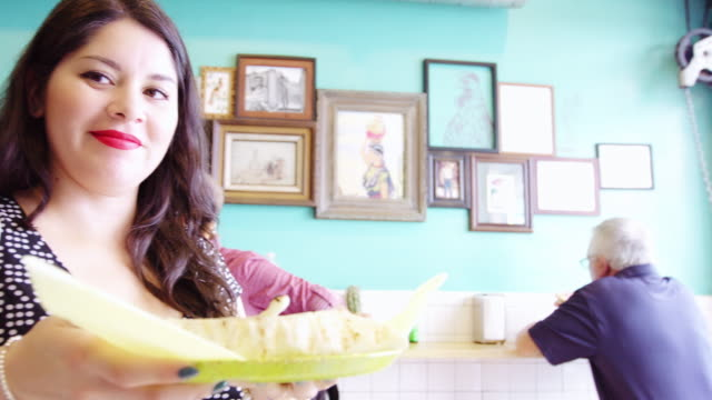 happy woman collecting food order in taqueria - taco stock videos & royalty-free footage