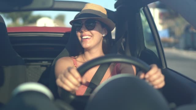 happy woman driving car, enjoying vacations - front view stock videos & royalty-free footage