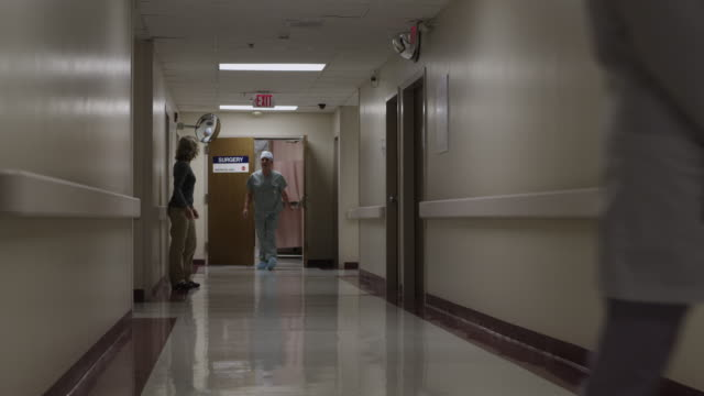ws happy woman embracing surgeon in hospital corridor / payson, utah, usa - ペイソン点の映像素材/bロール