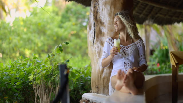 happy woman enjoying in her drink on a terrace. - smoothie stock videos & royalty-free footage