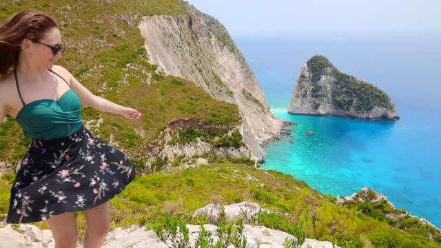 happy woman enjoying the stunning coastline of the zakynthos island in greece. - skirt stock videos & royalty-free footage