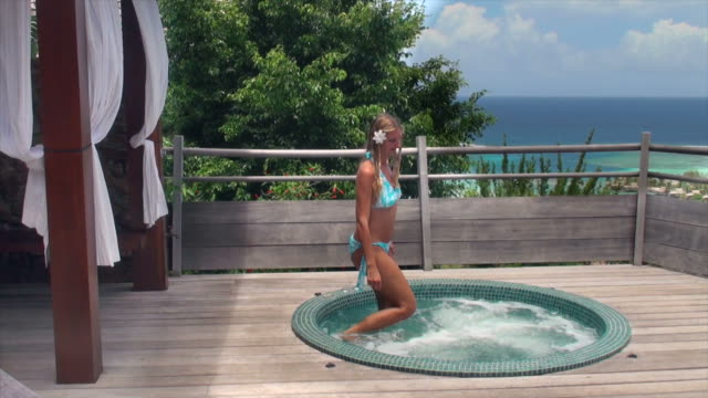 stockvideo's en b-roll-footage met happy woman enters the spa on her terrace - gazebo