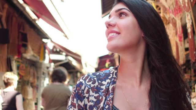 happy woman exploring a street market, istambul, turkey - turchia video stock e b–roll