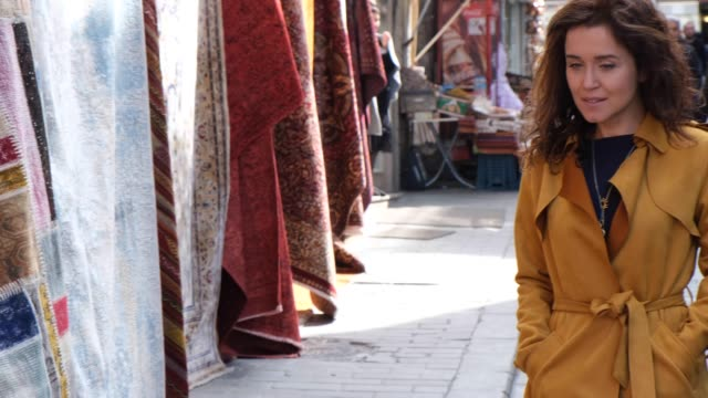 happy woman in the grand bazaar - grand bazaar istanbul stock videos & royalty-free footage
