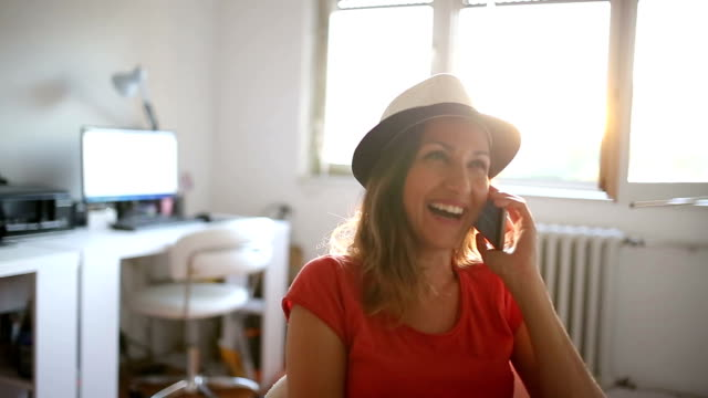 Happy Woman laughing and talking on the phone