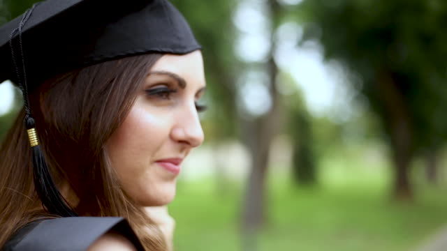happy woman on her graduation day . education and people. - graduation clothing stock videos & royalty-free footage