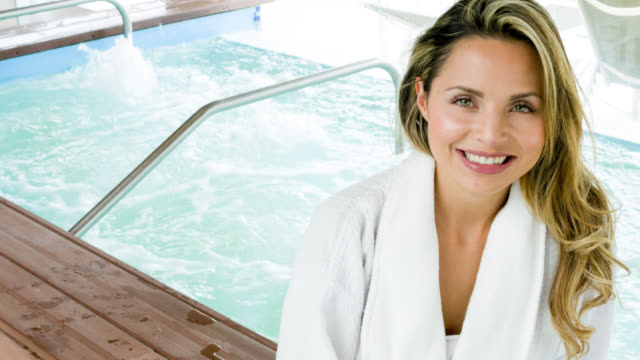 happy woman relaxing at the spa - hydrotherapy stock videos & royalty-free footage