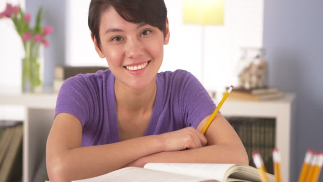 Happy woman smiling with books