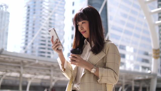 happy woman using mobile phone - holding stock videos & royalty-free footage