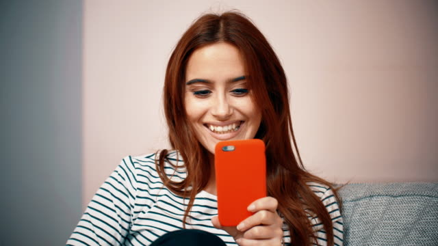 happy woman with her phone. - luck stock videos & royalty-free footage