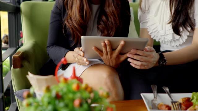 Happy women on digital tablet