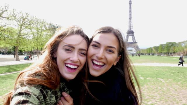 happy women taking selfie in paris - eiffel tower stock videos and b-roll footage