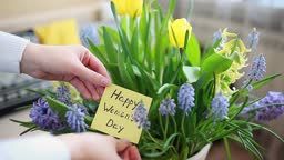 Happy Womens Day, 8 March gift. Woman holds card with blooming spring flowers