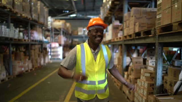 happy worker dancing at warehoue - manufacturing occupation stock videos & royalty-free footage