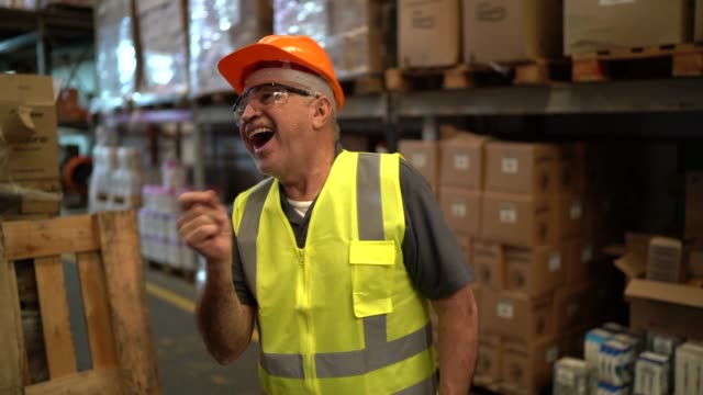 happy worker dancing inside distribution warehouse - manufacturing occupation video stock e b–roll