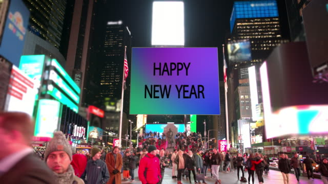 幸せな年ニューヨーク タイムズ スクエア人商業サイン看板 - 年越し点の映像素材/bロール