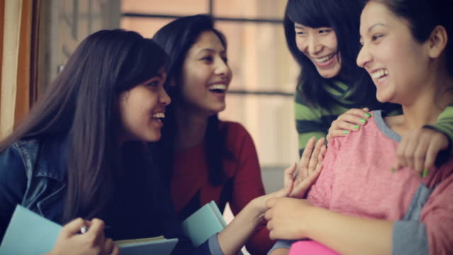 happy young adult multi ethnic female students having fun together. - indian ethnicity stock videos and b-roll footage