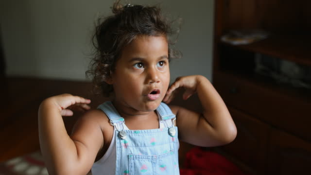happy young australian aboriginal girl learning to sing and dance to a song - pacific islander stock videos & royalty-free footage