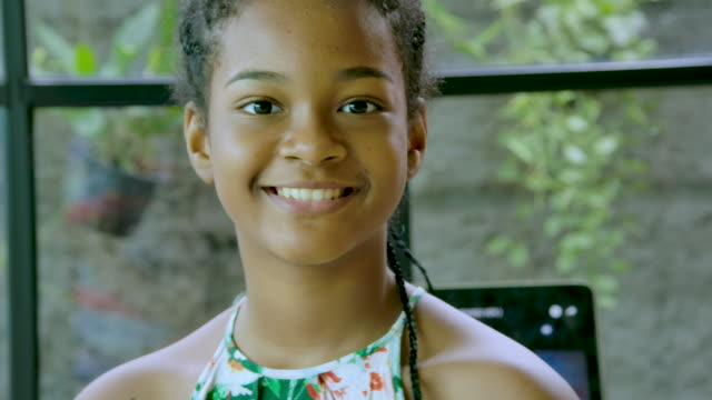 happy young black girl looking at camera, smiling - sequential series stock videos & royalty-free footage