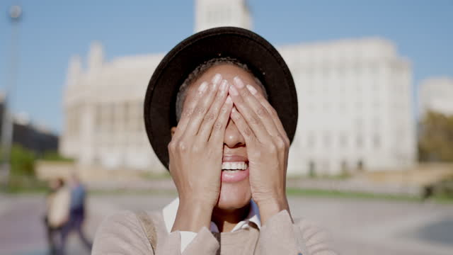 happy young black woman covering her face with hands - video portrait stock videos & royalty-free footage