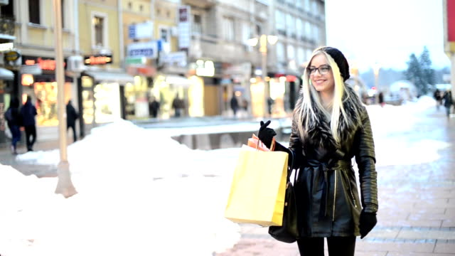 happy young blonde woman with shopping bags in the city - bag stock videos & royalty-free footage