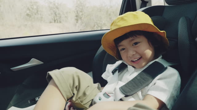 happy young boy to travel. - passenger seat stock videos & royalty-free footage