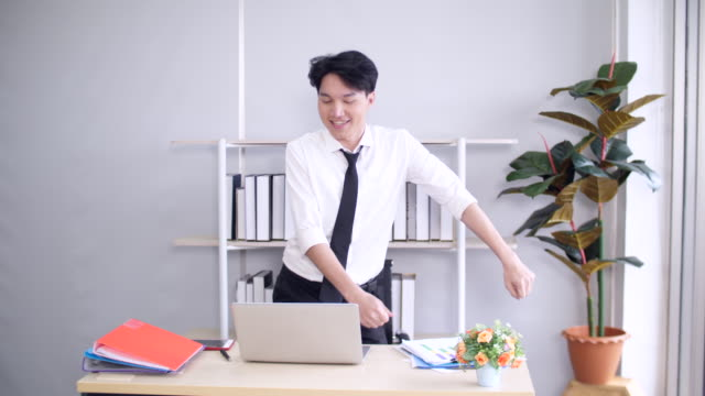 happy young businessman at office, young businessman dancing in office - east asian ethnicity stock videos & royalty-free footage