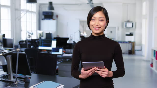 happy young businesswoman standing in the office - standing stock videos & royalty-free footage