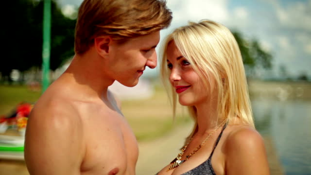 happy young couple flirting at the lake - romance stock videos & royalty-free footage