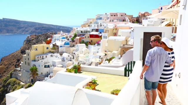 hd: happy young couple on santorini island, greece - oia santorini stock videos & royalty-free footage