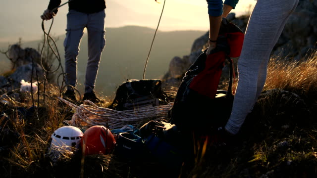 happy young couple packing climbing equipment for a hike in the alps - climbing equipment stock videos & royalty-free footage
